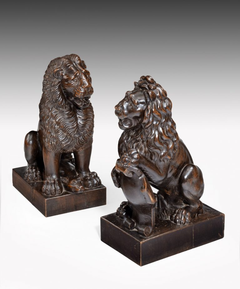 Pair of antique carved lions